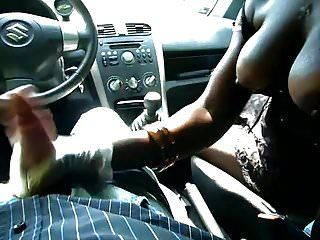 Ebony cutie with large breasts gives cook jerking in car