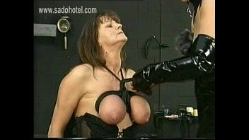 Masked female-dominator in latex ties the large whoppers of villein with jointly with a rope and hits em