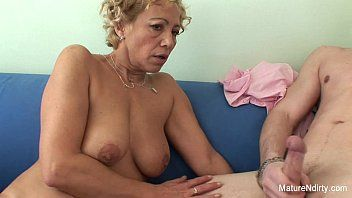 Golden-haired granny receives cum on her mambos